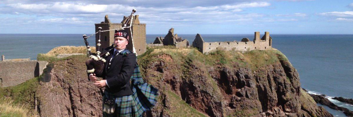 Grant MacLeod Munro Bagpiper Castle